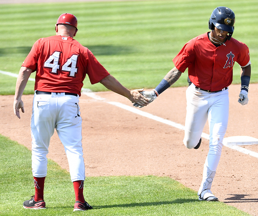 Jordyn Adams (right) is congratulated by Bees manager Jack Howell after a solo home run in Sunday's game against Lake County. (Steve Cirinna/Burlington Bees)